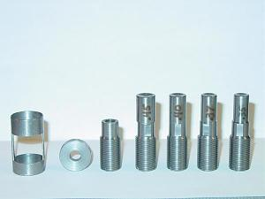 Star Parts from L to R: Saeco adapter, bottom washer for die puller, threaded die puller, .450, .400. 370, .350 diameters.